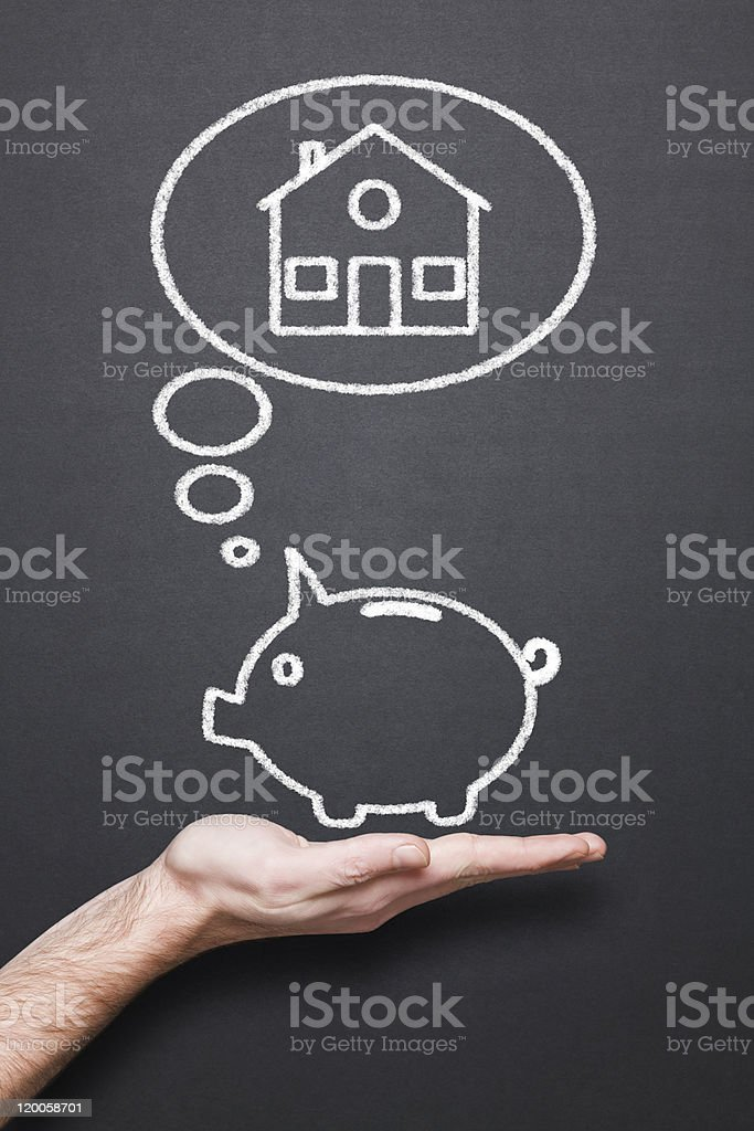 chalkboard with hand, piggy bank and thought bubble stock photo