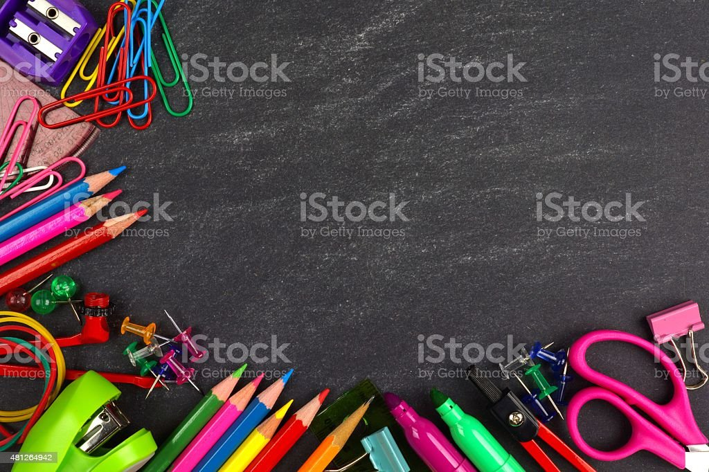 Chalkboard with school supplies corner border stock photo