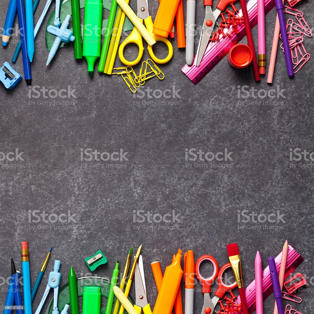 Chalkboard with school supplies on top and bottom borders stock photo