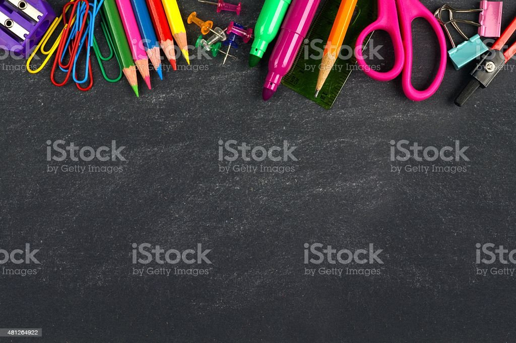 Chalkboard with school supplies top border royalty-free stock photo