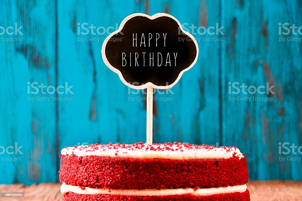 chalkboard with the text happy birthday in a cake stock photo