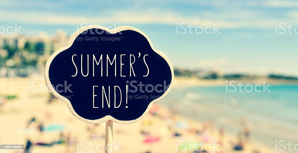 chalkboard with the text summers end in a beach stock photo