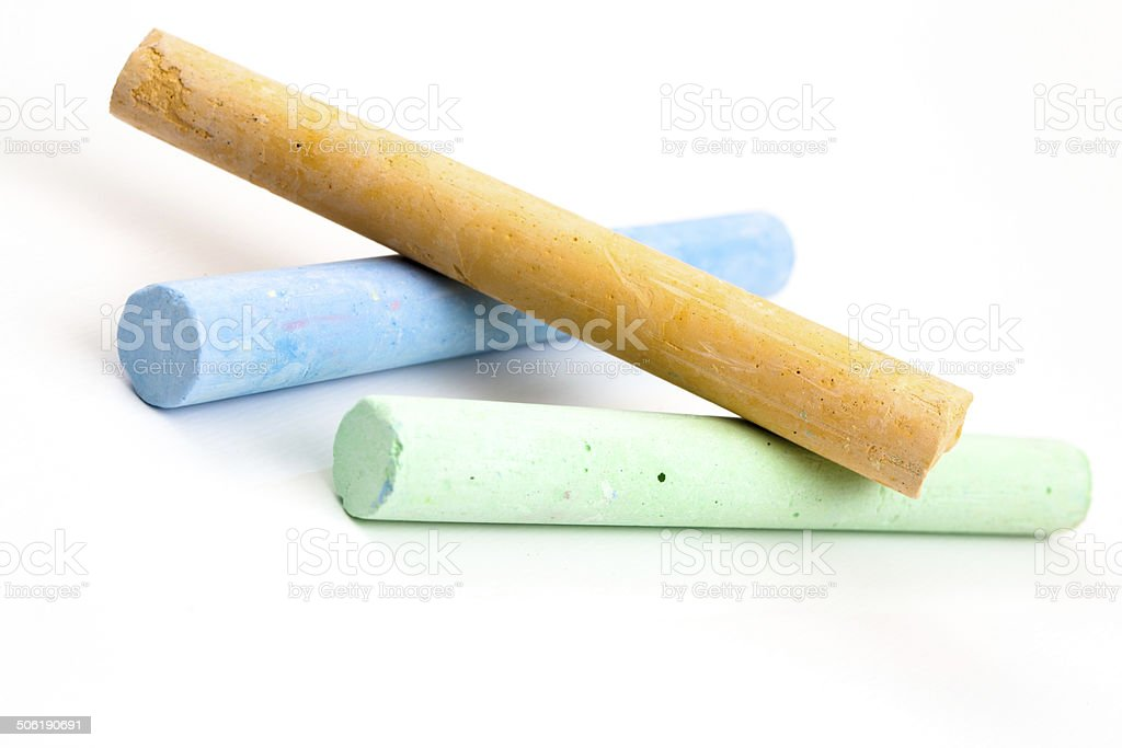 chalks in a variety of colors over white royalty-free stock photo