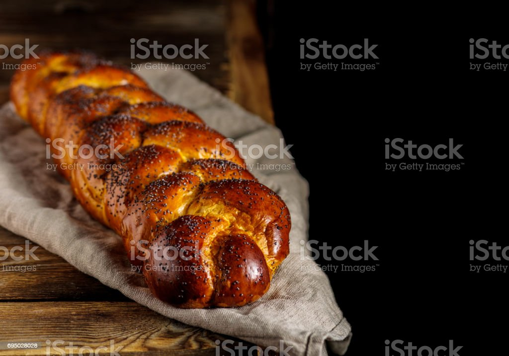 Challah or Hala is a traditional jewish sweet fresh sabbath bread loaf. stock photo
