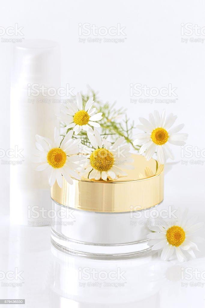 chamomile and jars of cream stock photo