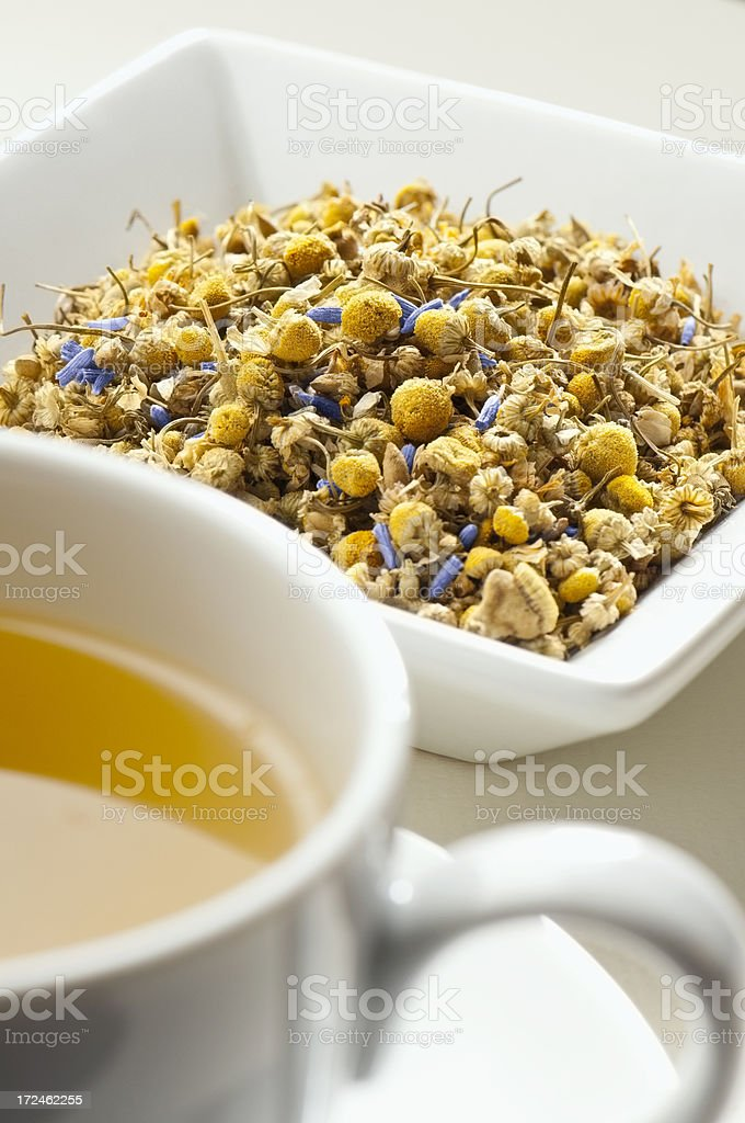 Chamomile and Lavender tea leaves behind cup of tea royalty-free stock photo