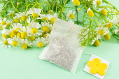 Chamomile flowers and a chamomile tea bag