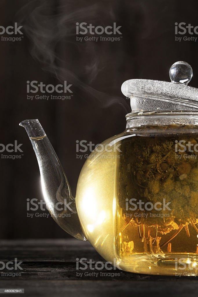 Chamomile Tea in a Clear Teapot stock photo