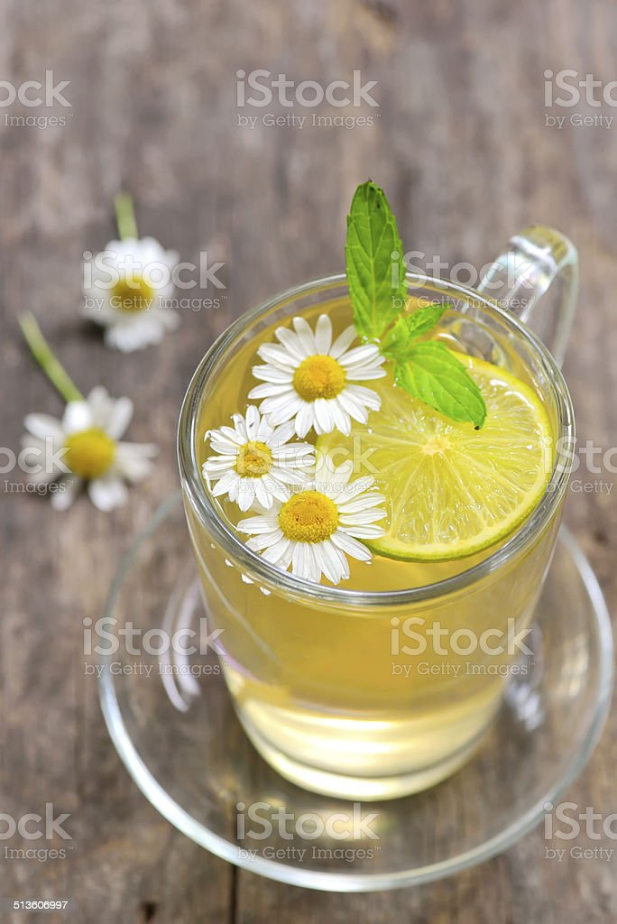 Chamomile tea in a glass cup stock photo