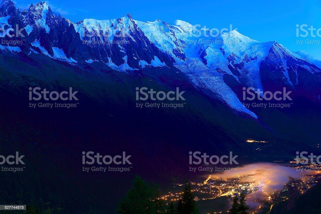 Chamonix Mont Blanc illuminated at night, French Alps stock photo
