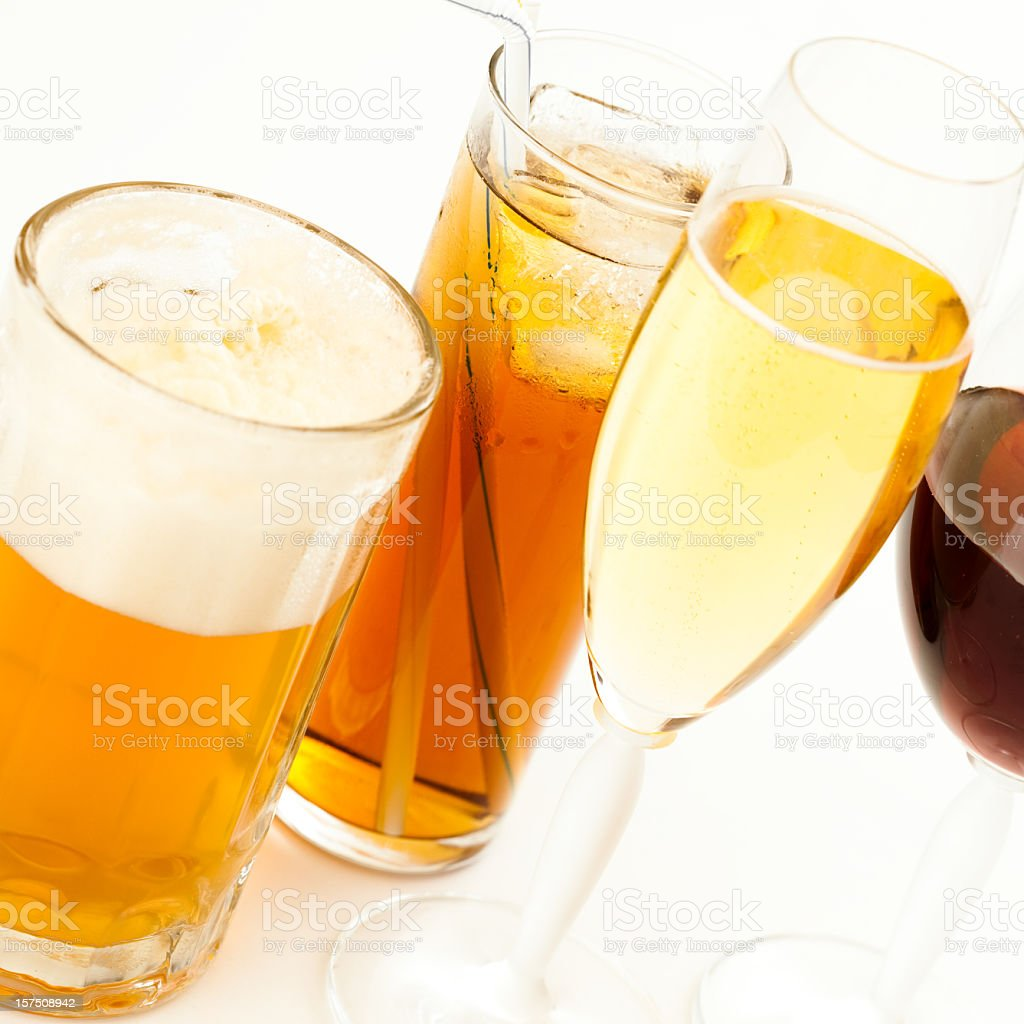 Champagne alongside wine, iced tea and beer on white counter stock photo
