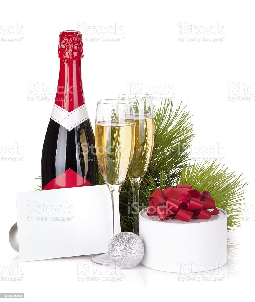 Champagne and christmas gifts royalty-free stock photo