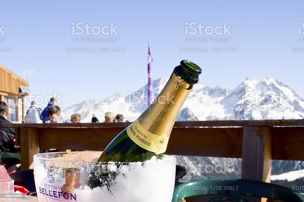 champagne and dining in mountain ski restaurant Courchevel stock photo