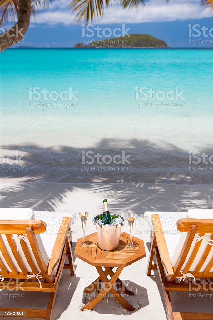 champagne and flutes at a tropical Caribbean beach stock photo