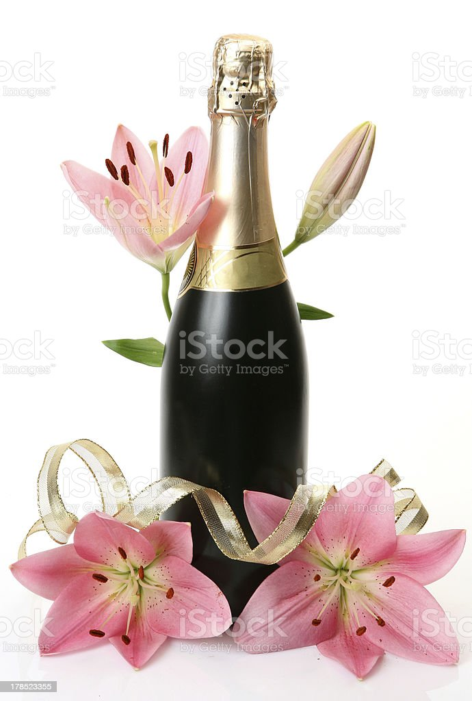 Champagne and pink lilies royalty-free stock photo