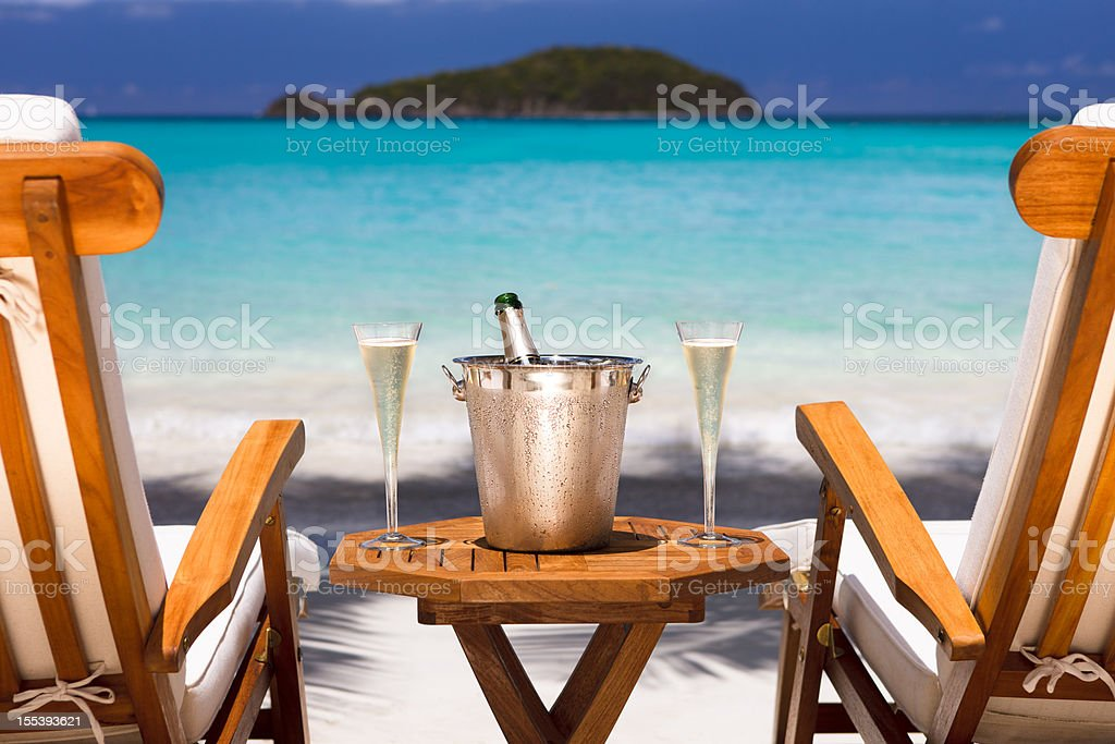 champagne and recliners on a tropical beach in the Caribbean stock photo