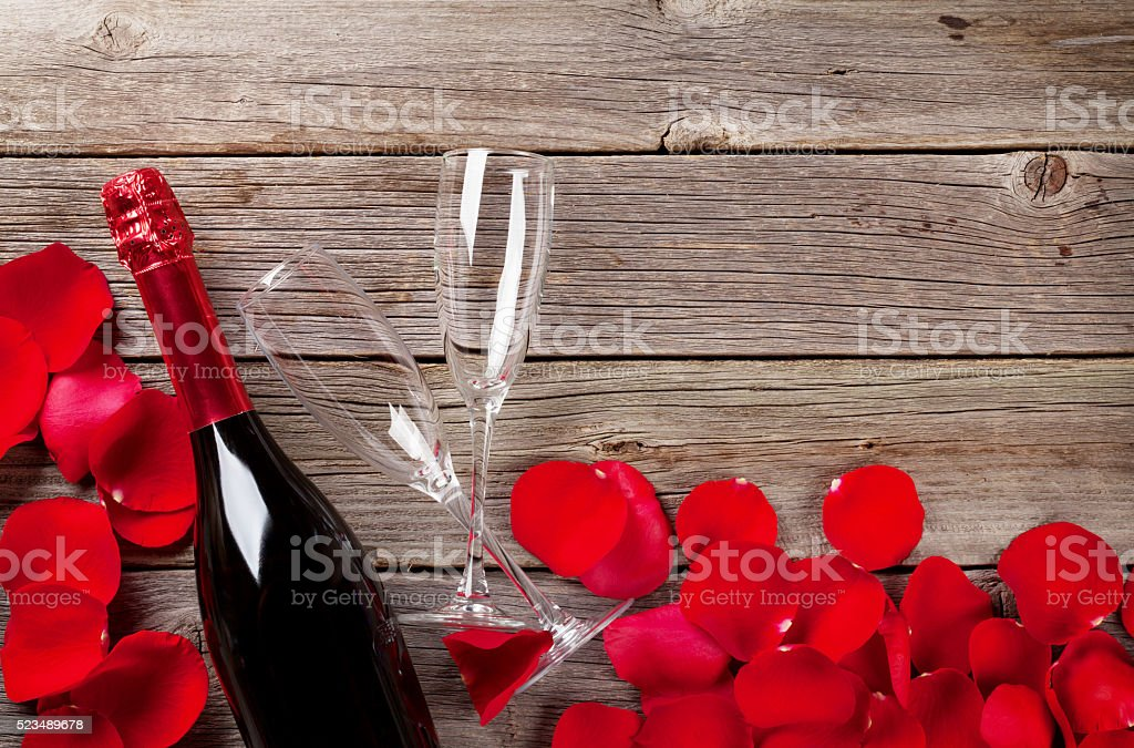 Champagne and rose petals stock photo