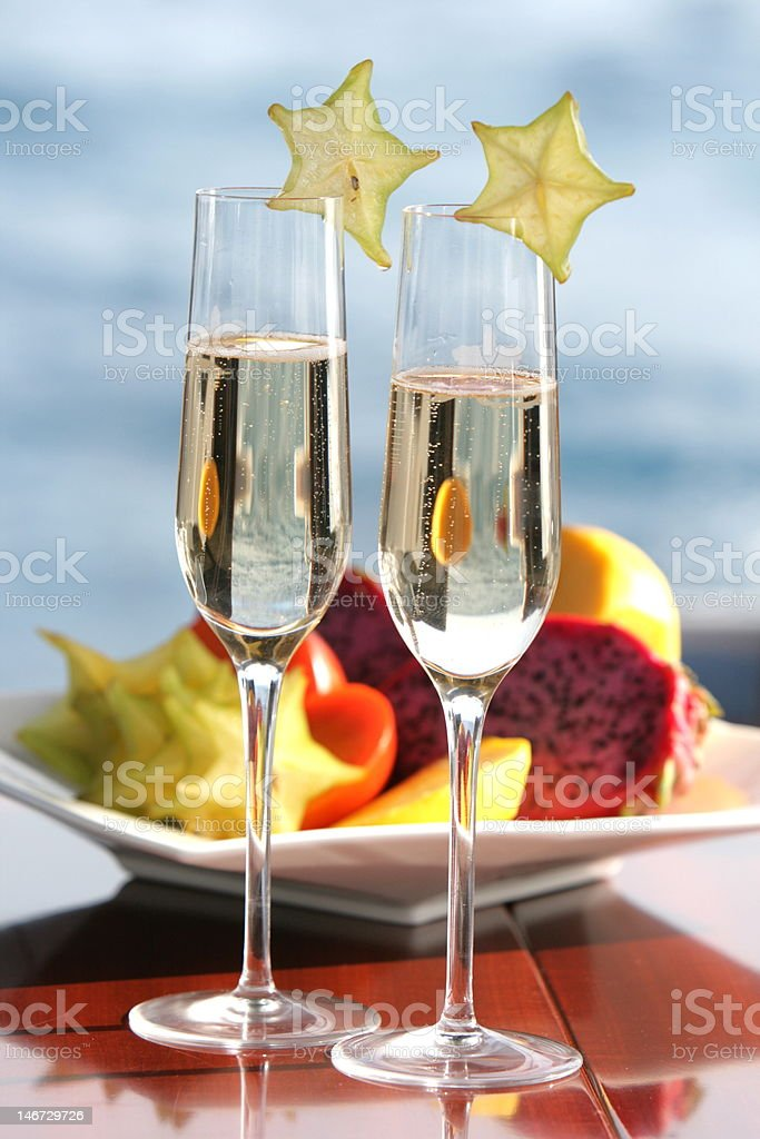 Champagne and Starfruit royalty-free stock photo