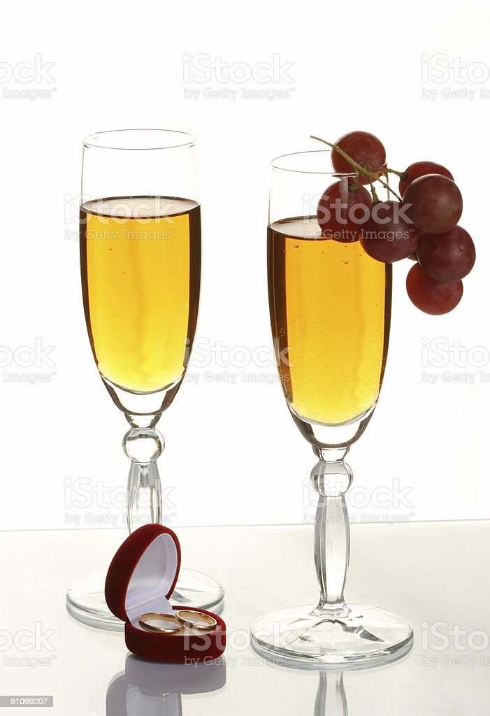 Champagne and wedding rings royalty-free stock photo