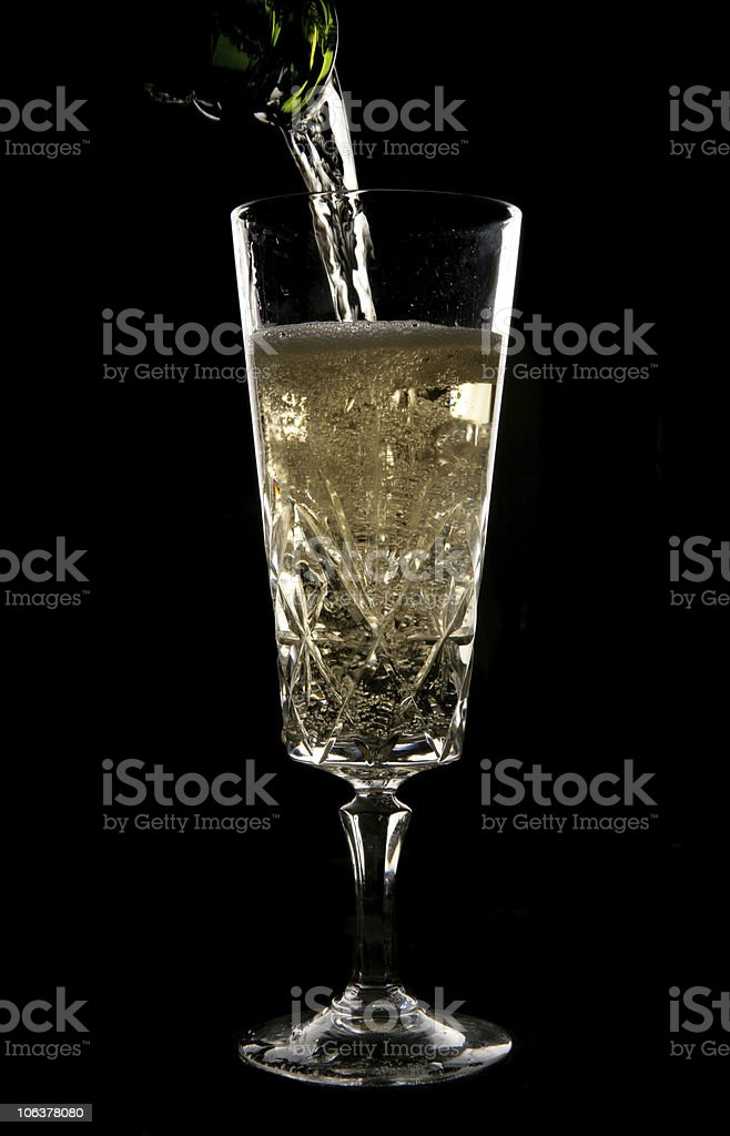 Champagne being poured in crystal glass royalty-free stock photo