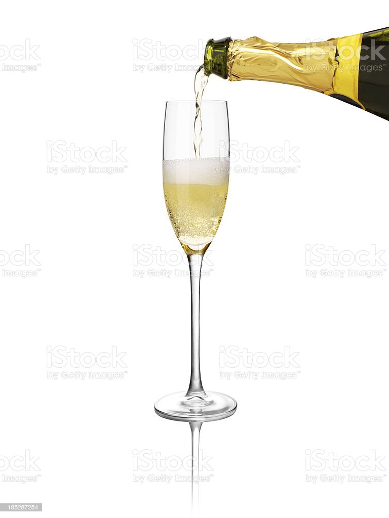 champagne being poured into a glass royalty-free stock photo