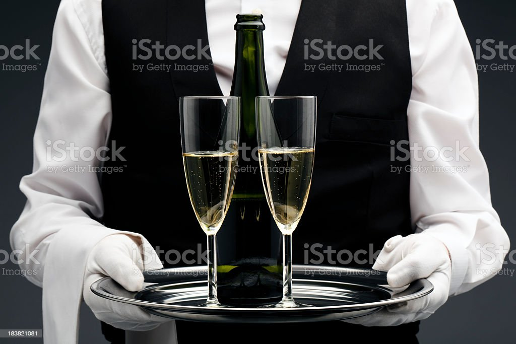 Champagne being served by a waiter stock photo