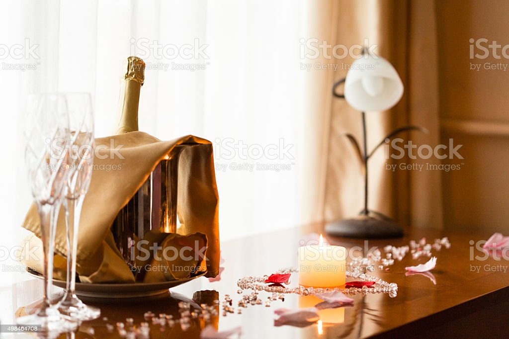 Champagne bottle and ice bucket on the table stock photo