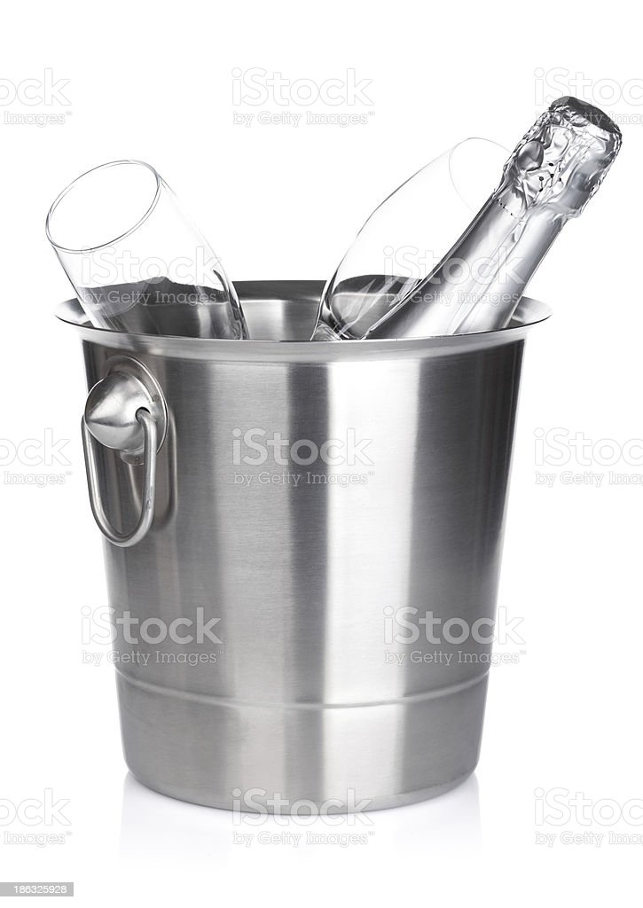 Champagne bottle in bucket and empty glasses royalty-free stock photo