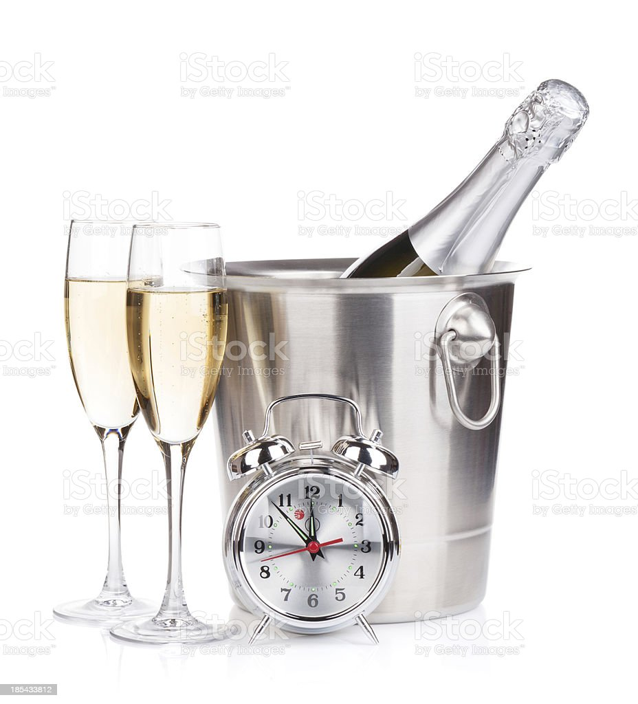Champagne bottle in bucket, two glasses and alarm clock royalty-free stock photo