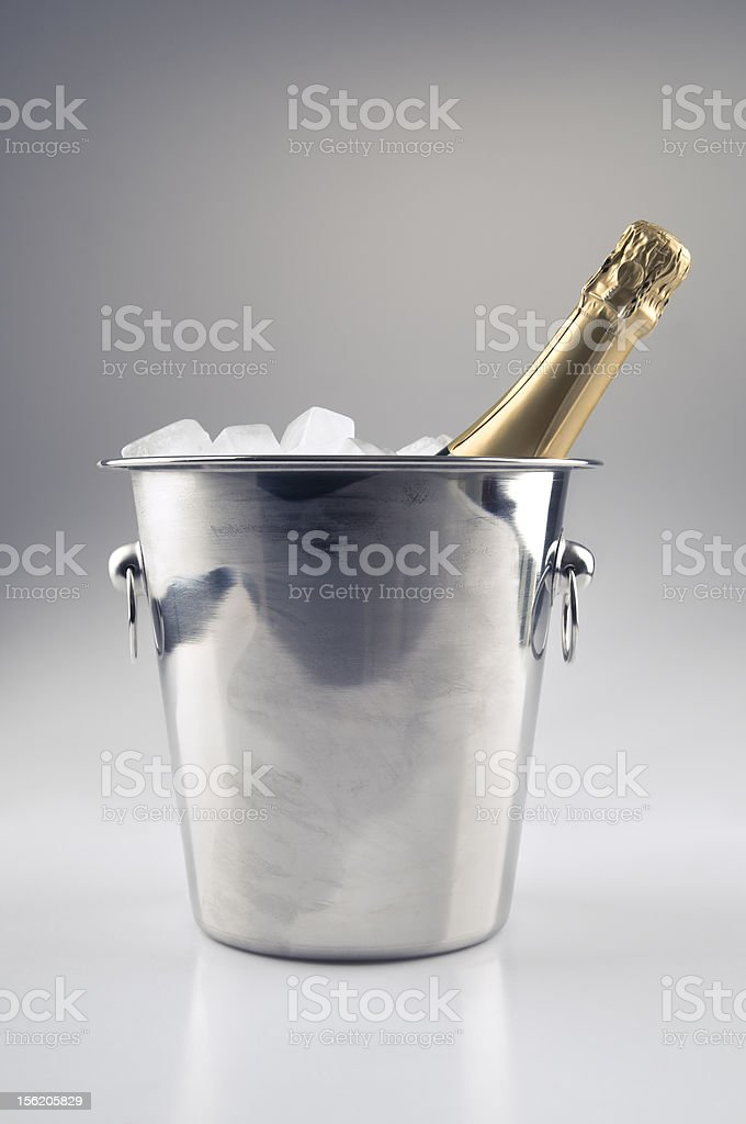 Champagne bottle in ice bucket royalty-free stock photo