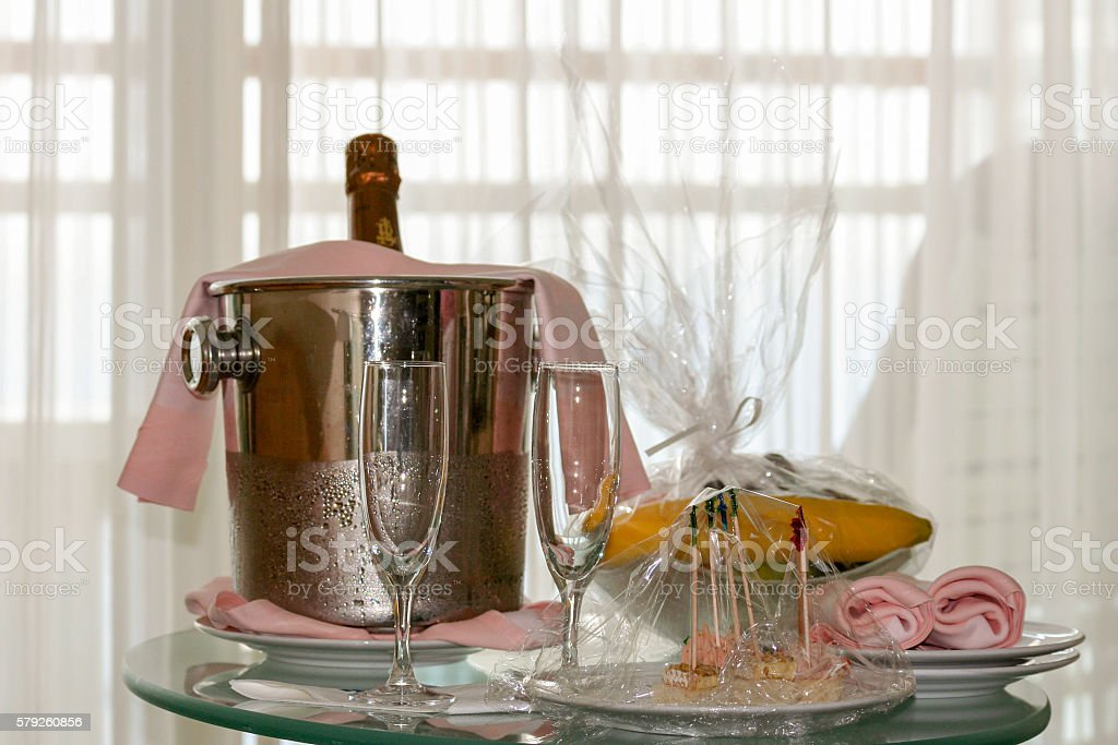 Champagne bottle in ice bucket stock photo