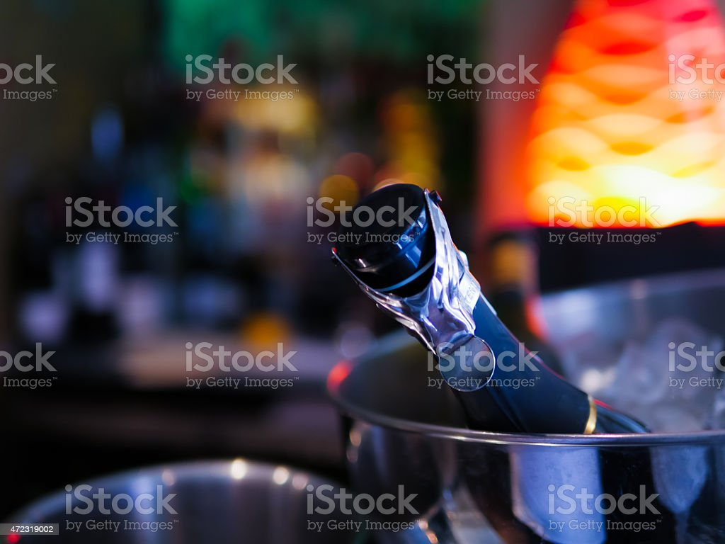Champagne Bottle in Ice Cooler stock photo