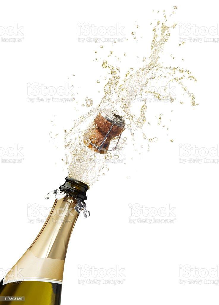 Champagne bottle popping its cork and splashing royalty-free stock photo