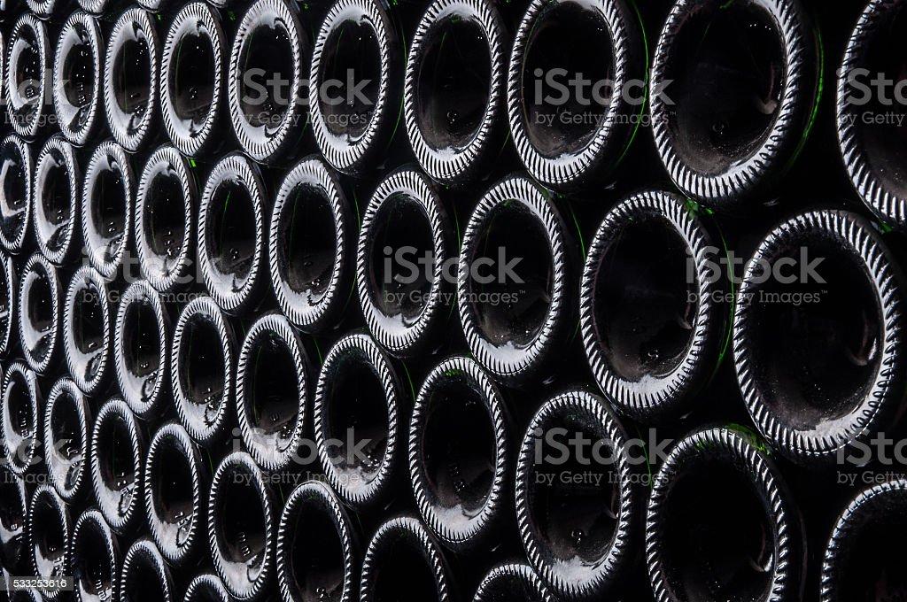 champagne bottles resting on lees stock photo