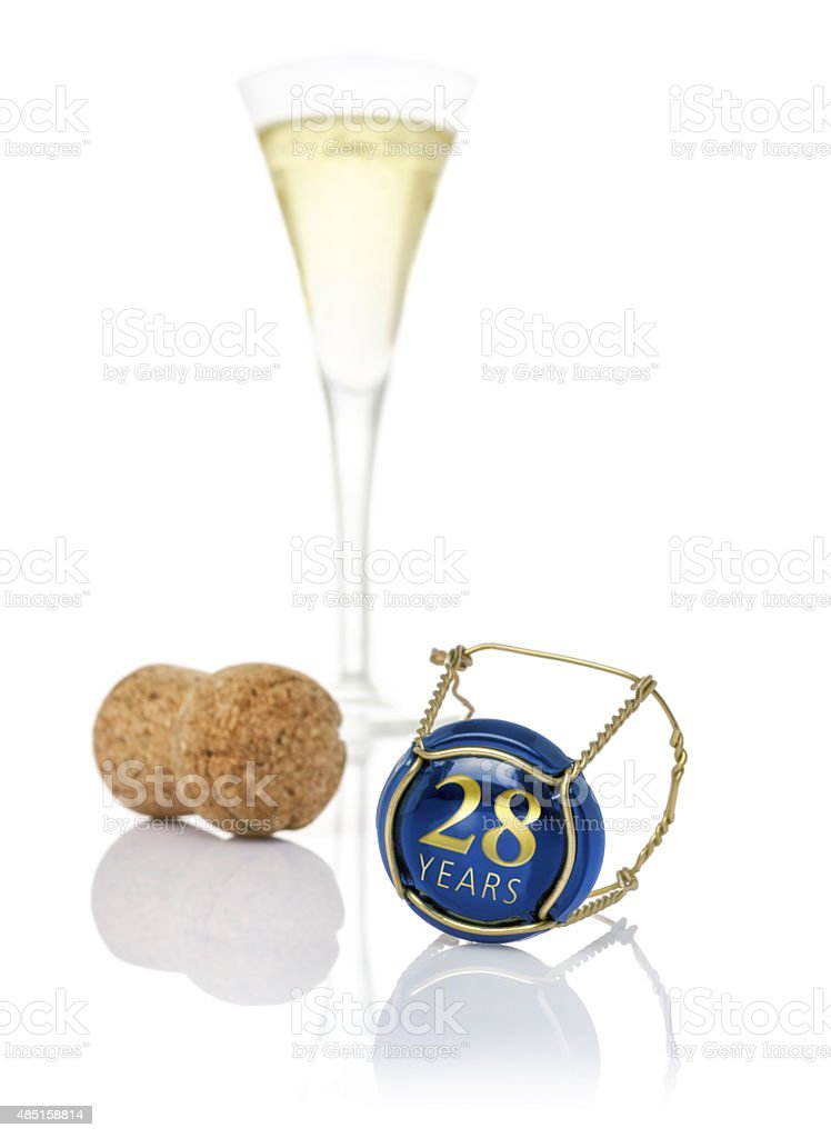 Champagne cap with the inscription 28 years stock photo