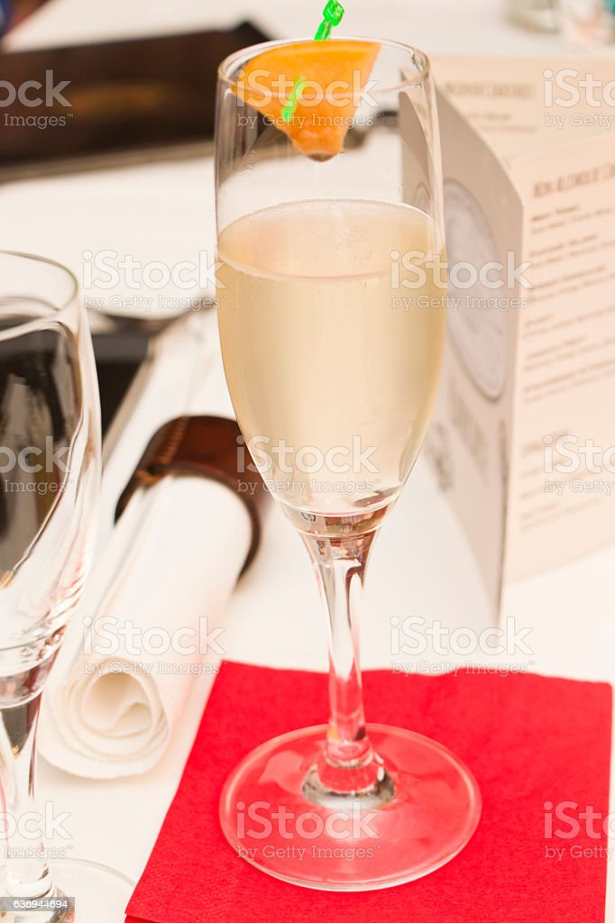 Champagne cocktail with quince juice stock photo