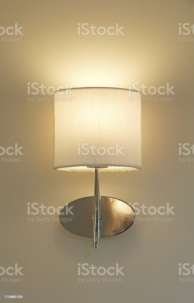 champagne coloured wall lamp stock photo