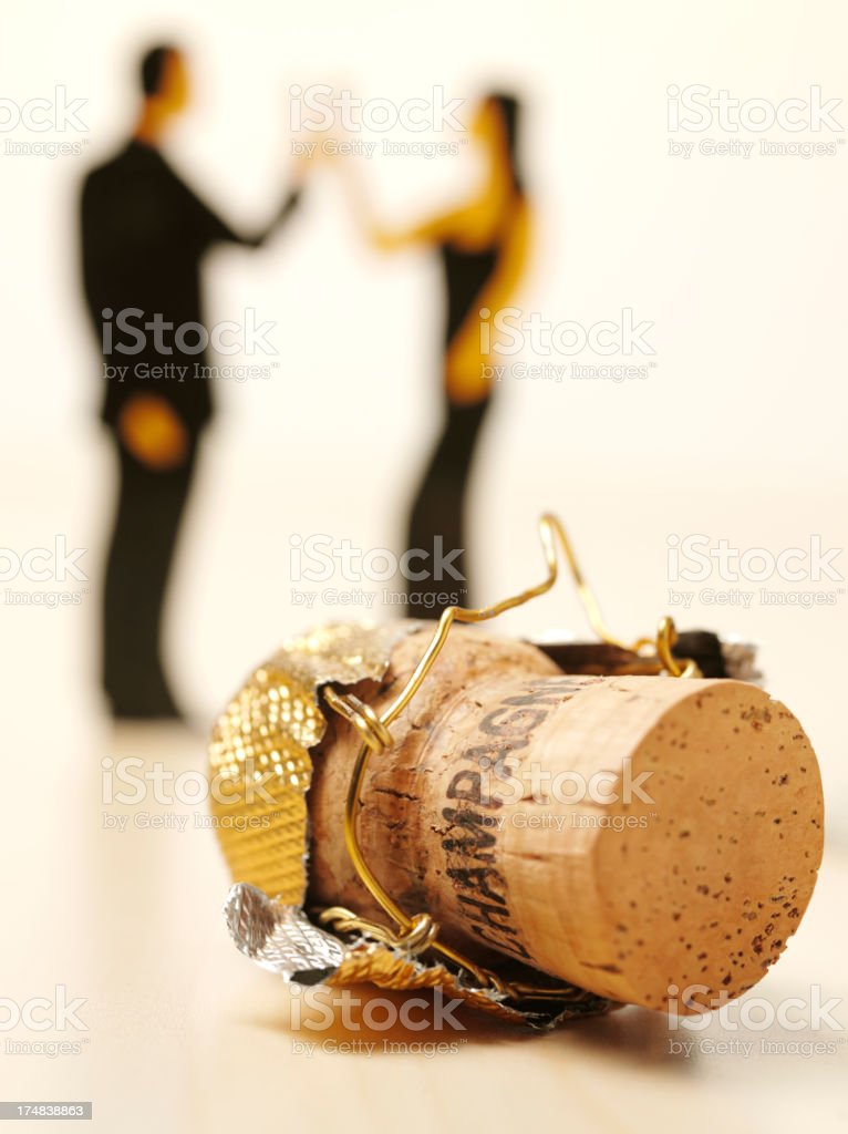 Champagne Cork and People Celebrating royalty-free stock photo