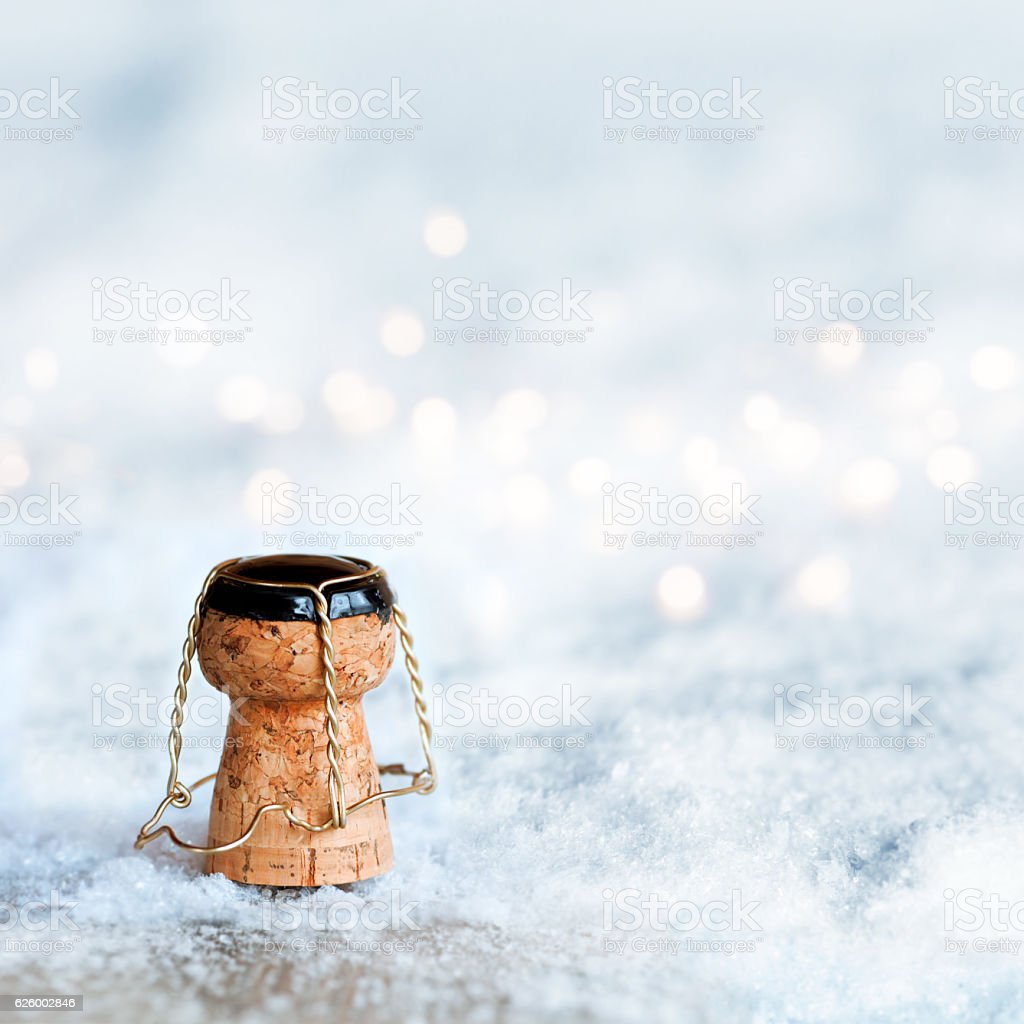 Champagne cork in the snow stock photo