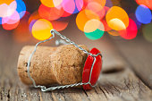 Champagne cork on a wooden table in front Christmas tree