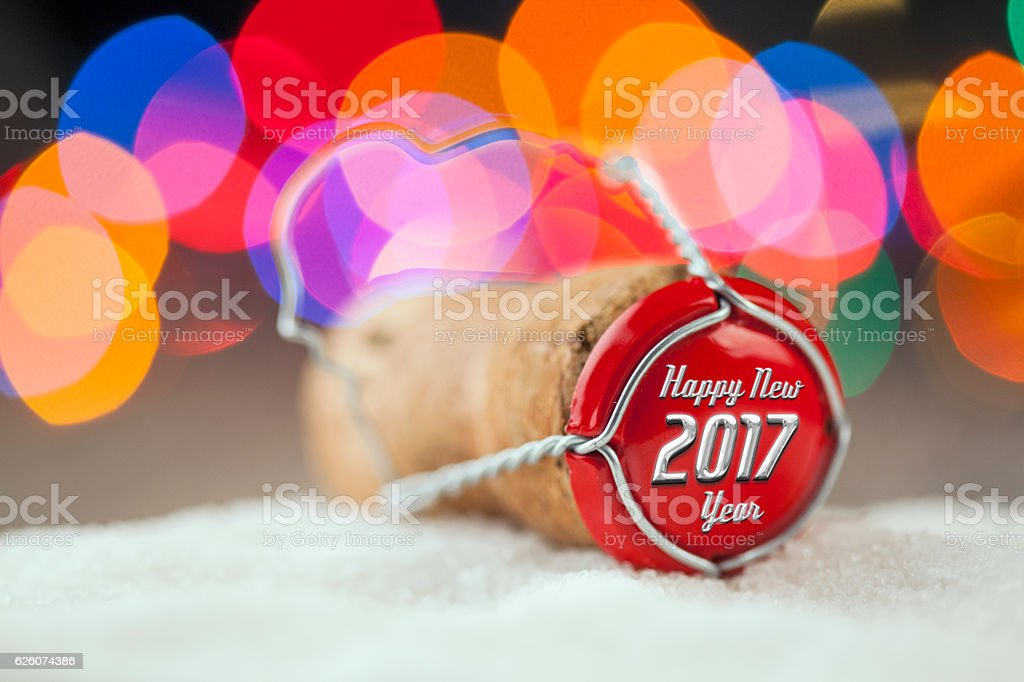 Champagne cork on the Snow in front Christmas tree stock photo