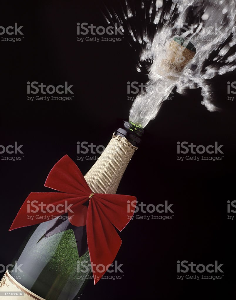 Champagne cork popping stock photo