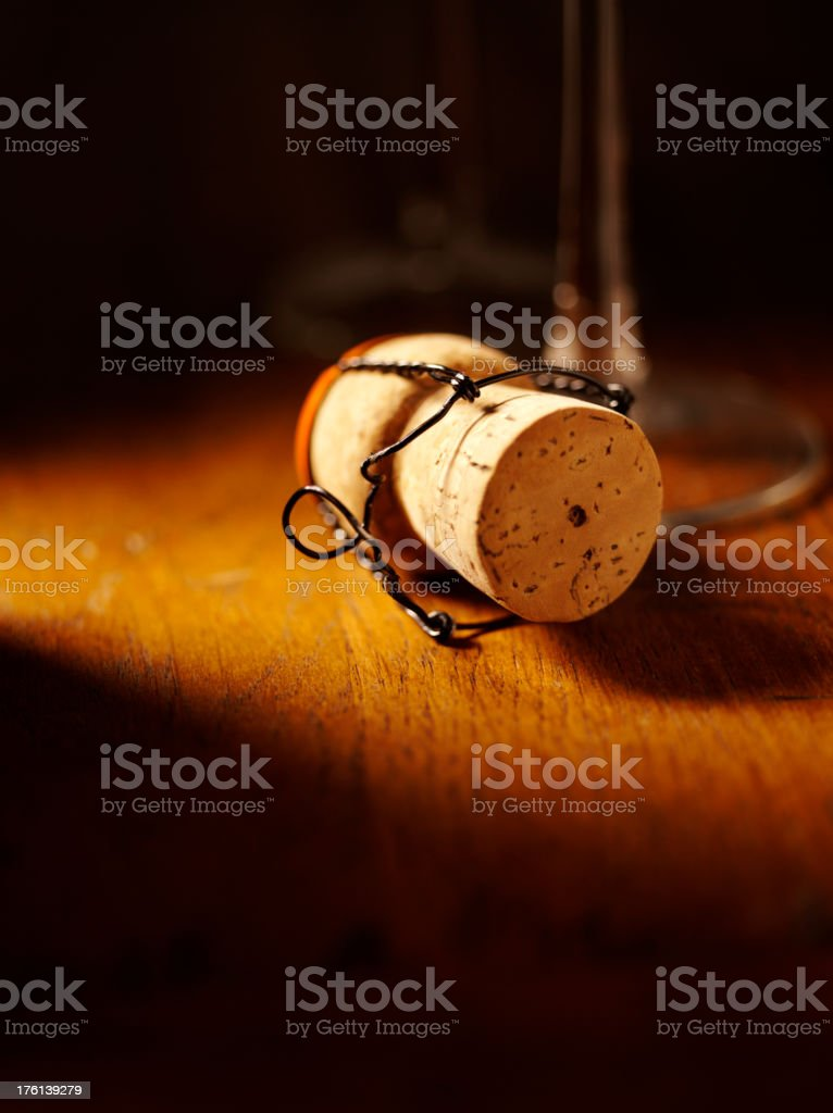 Champagne Cork, with Glass Stem on a Table stock photo
