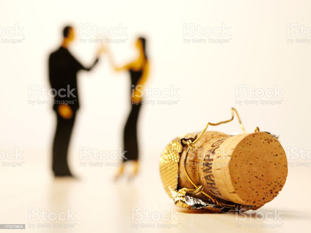 Champagne Cork with People Toasting at a Party royalty-free stock photo