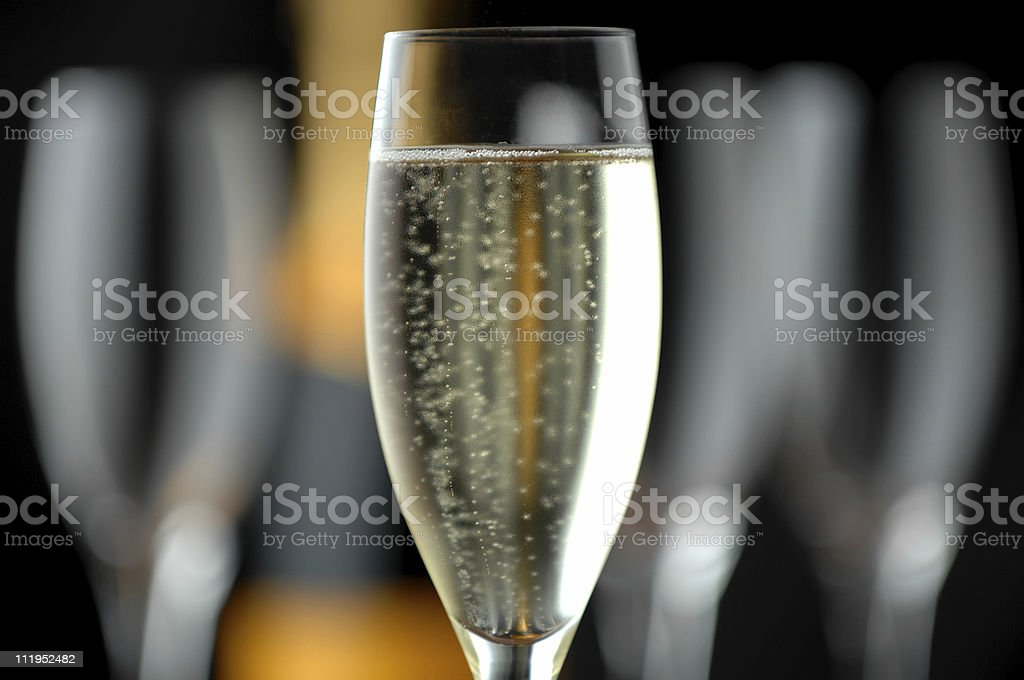 champagne flute and bottle on Black royalty-free stock photo