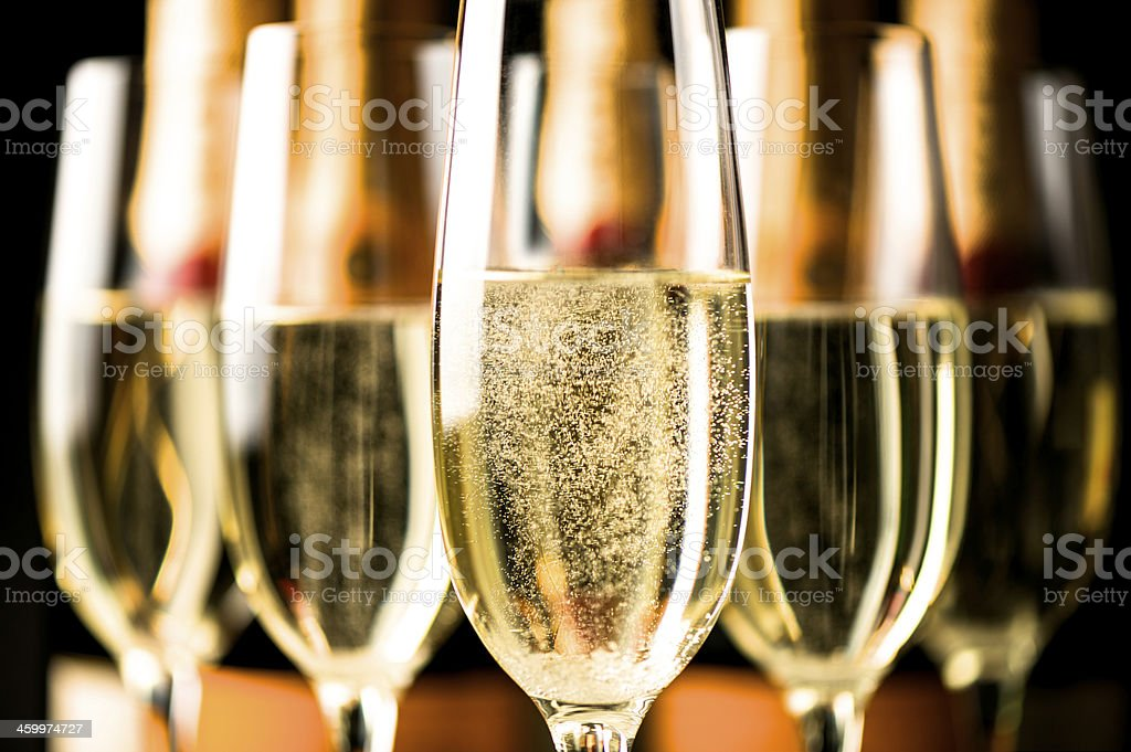 champagne flute and bottle on Black stock photo