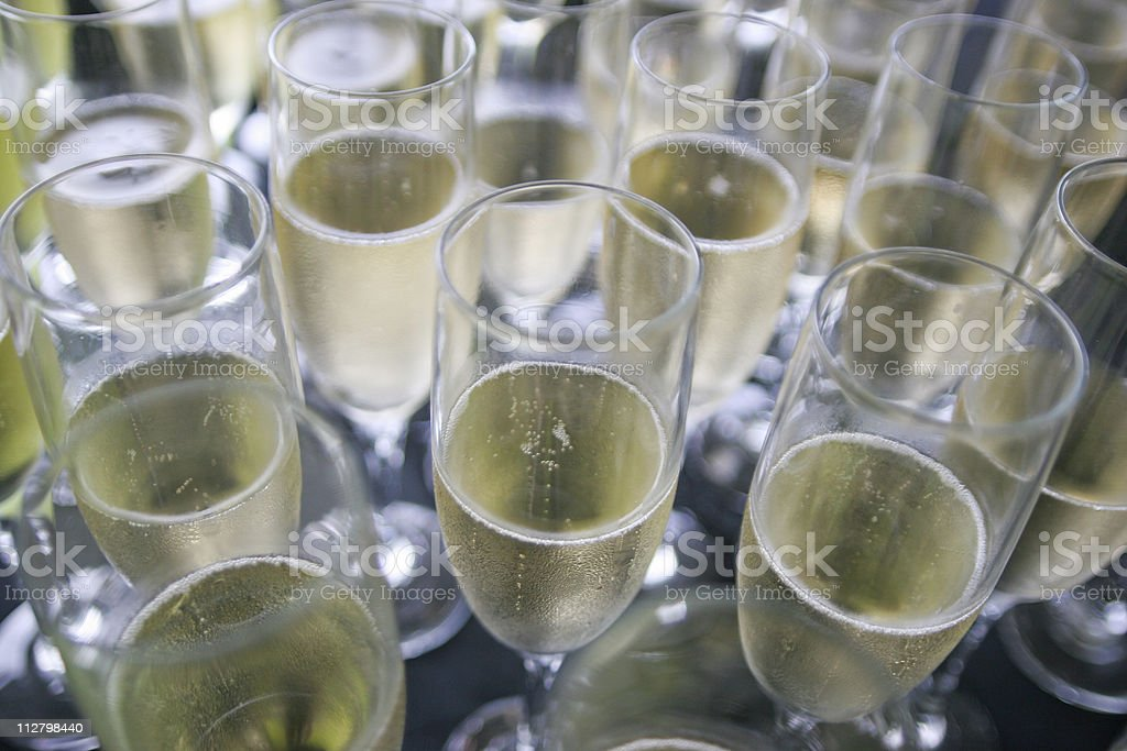 Champagne Flute Glasses filled with bubbly wine royalty-free stock photo