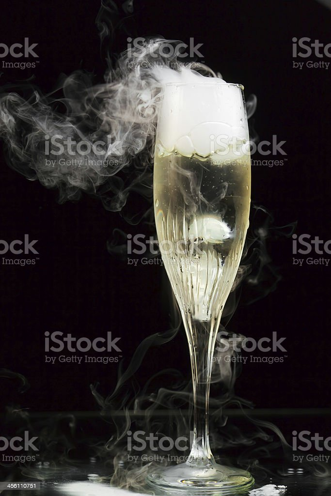 champagne flute with ice vapor stock photo