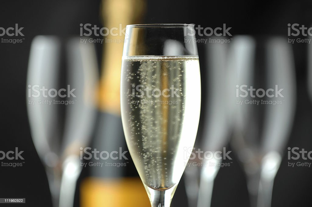 Champagne Flutes and Bottle on Black royalty-free stock photo