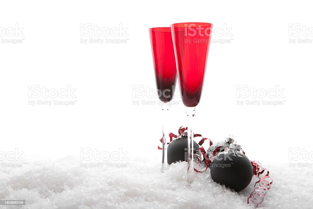 Champagne Flutes and Christmas Ornamanets royalty-free stock photo